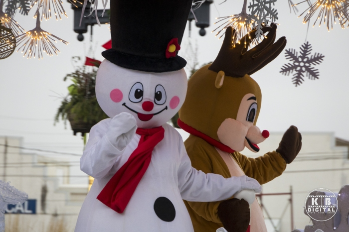 Frosty and Rudolph wave at the crowd.